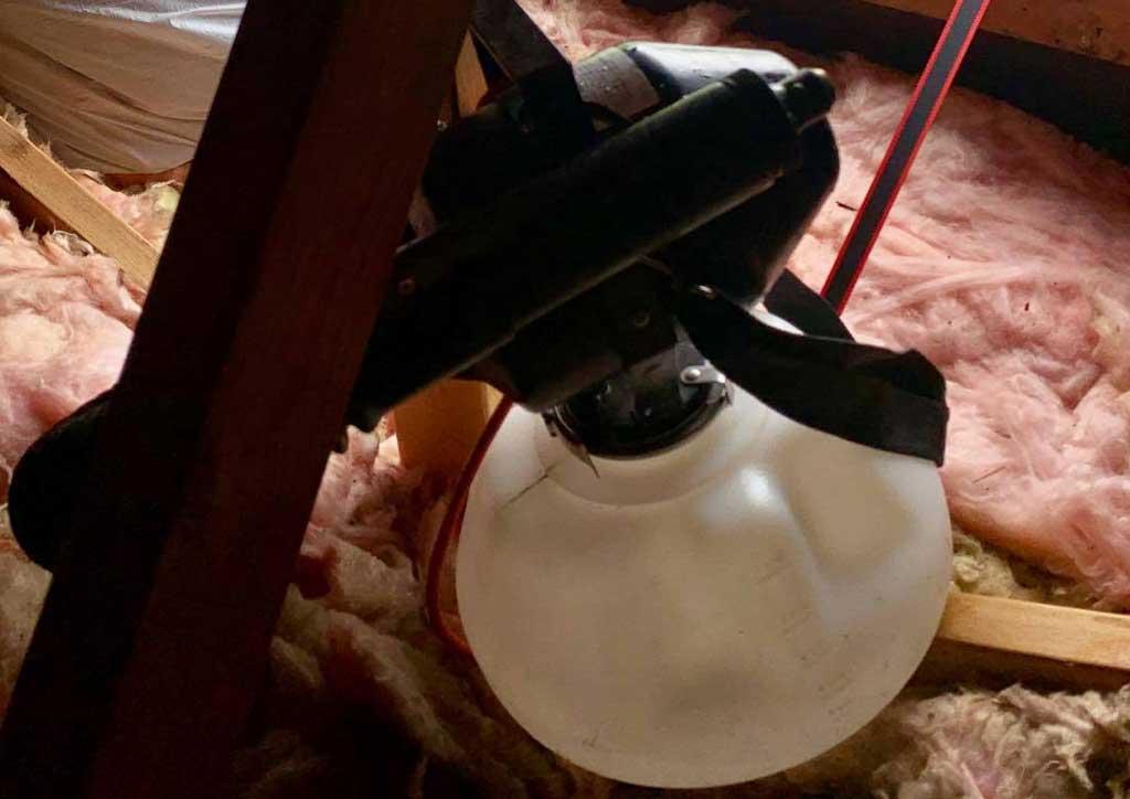 Attic Disinfect Deodorize Service Photo of a Fogger